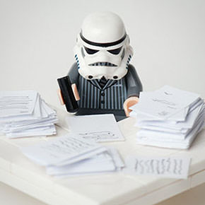 LEGO Stormtrooper in a suit working at a desk